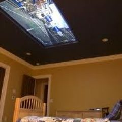 Plasma TV on Bedroom Ceiling